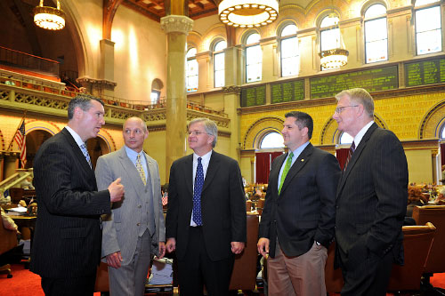 New York State Assemblyman Fred W. Thiele, Jr. joins fellow Assemblymen and Brookhaven Town Supervisor Mark Lesko in discussing legislation which would better protect the ecological integrity of the Carmans River. This legislation, which passed both the Assembly and Senate last week, will add additional lands in the Carmans River Watershed to the Core Preservation Area of the Central Pine Barrens.