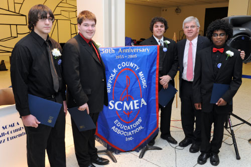Assemblyman Fred Thiele greets local high school students participating in the Suffolk County Music Educators� Association (SCMEA) All-County Vocal Jazz Ensemble who performed in Albany to celebrate the New York State School Music Association�s (NYSSMA) 9th Annual Music In Our Schools Month.