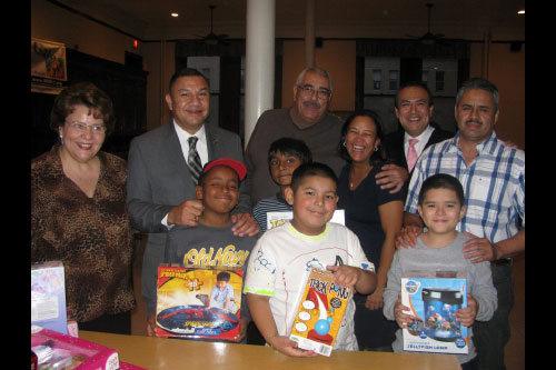 Assemblyman Ramos presents children from Shepherd�s Gate Academy in Brentwood with gifts in celebration of Three Kings Day. More than 100 children who attend after-school programs at Shepherd�s Gate received toys donated by local residents and businesses in celebration of the holiday.