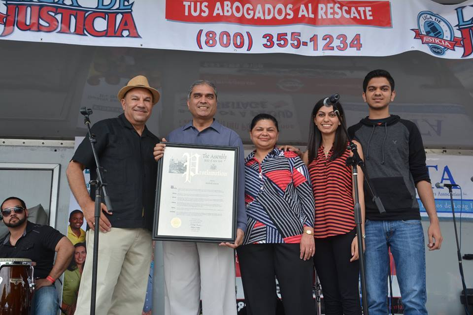 Assemblyman Ramos honors Bhadresh �Bob� Acharya, owner of Brentwood Pharmacy, at the 2015 Brentwood Arts & Salsa Festival.