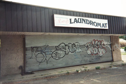 Graffiti tagged on a local laundromat was soon to be cleaned by the graffiti removal campaign sponsored by Assemblyman Ramos