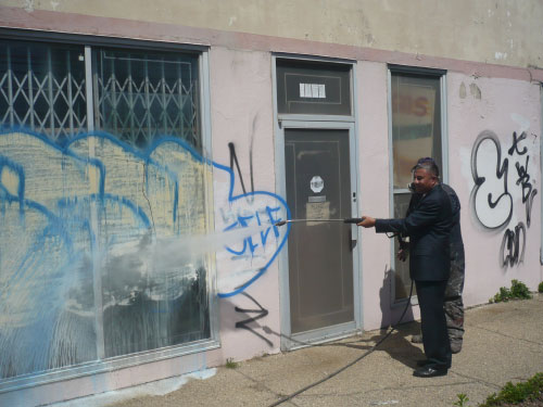 Assemblyman Ramos demonstrates how graffiti will be removed from buildings and other surfaces throughout the community thanks to a $40,000 grant he obtained to establish the 6th Assembly District Graffiti Removal Campaign