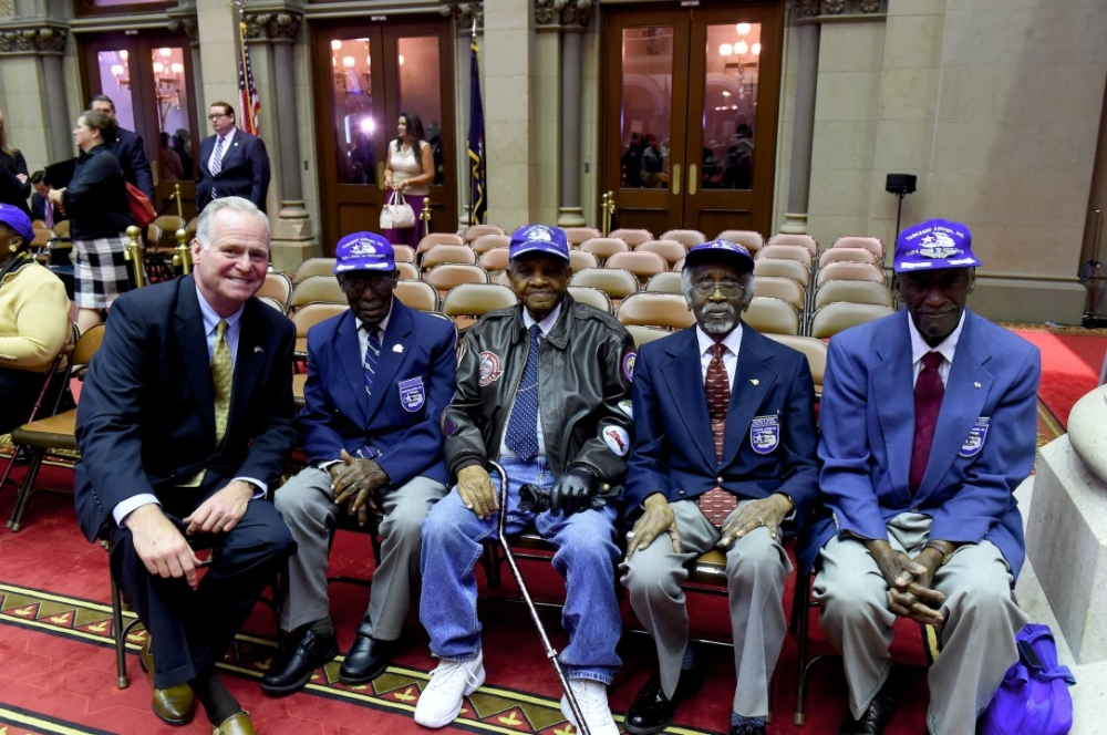 Assemblyman Michael Fitzpatrick (R,C,I-Smithtown) welcomed Tuskegee Airmen (L to R) Audley Coulthurst, William J. Johnson, Wilford R. DeFour and Herbert C. Thorpe to the chamber on June 16 as they were honored by the Assembly.