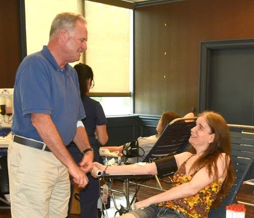 Assemblyman Michael Fitzpatrick (R,C,I-Smithtown), who also gave blood, greets local resident Kristy Conn as she gives a blood donation at his drive in Hauppauge.<br />