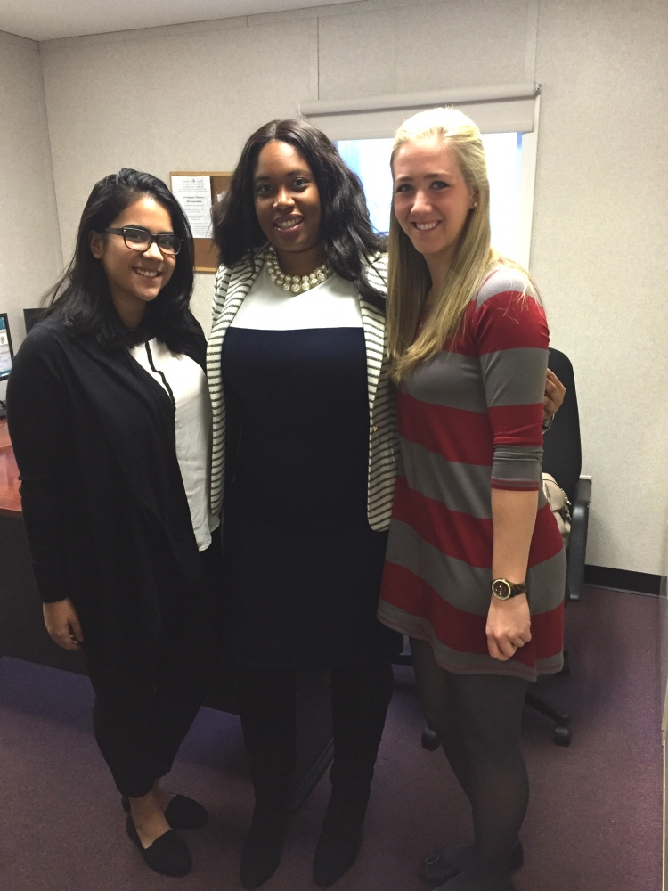 Assemblywoman Kimberly Jean-Pierre recognizes Melissa Cruz and Glynnis Budde (left to right) as two exceptional occupational therapy students from New York Institute of Technology.