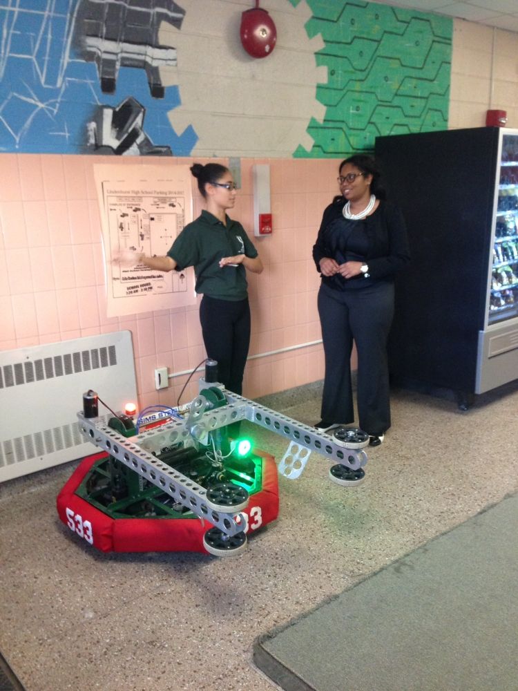 Assemblywoman Kimberly Jean-Pierre surveys a robot built by the Lindenhurst High School Robotics Club. The club is an after school program for students who inspire to succeed in STEM (science, technology, engineering and math) concentration.