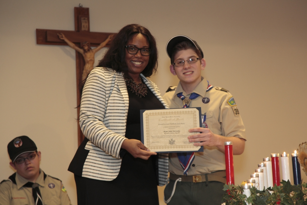 Assemblywoman Kimberly Jean-Pierre honors Boy Scout Bryan James McCarthy of Troop 399 for his selfless dedication to the community.