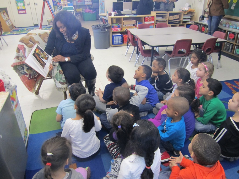 "Assemblywoman Kimberly Jean-Pierre reads ""The True Story of the Three Little Pigs"" to kindergarteners at Northeast Elementary School."