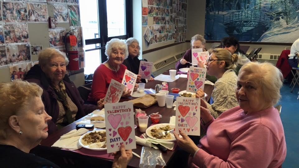 Assemblywoman Kimberly Jean-Pierre handing out Valentines cards to senior citizens.