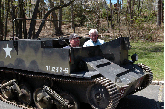 Assemblyman Charles Lavine, right, gets a ride in a World War II Universal Carrier called a Bren Carrier at Old Bethpage Restoration Village (OBRV). The Carrier will be part of the new Museum of American Armor at OBRV, 1303 Round Swamp Road, Old Bethpage, which will feature a permanent tribute to American servicemen and women. The museum will showcase a unique collection of armor in one building and create an educational destination for generations to come.