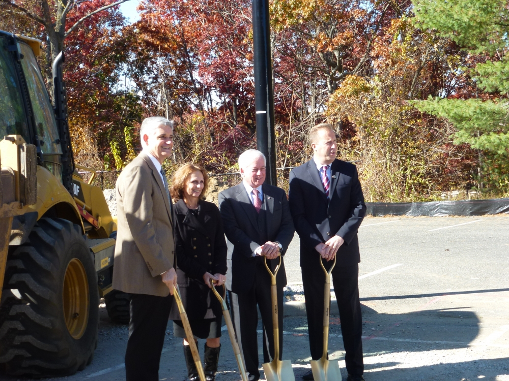 Assemblyman Charles Lavine (D-Glen Cove), second from right, assisted Cold Spring Harbor Laboratory President Bruce Stillman, left, with the groundbreaking for the construction of CSHL�s Pre-Clinical Experimental Therapeutics (PET) facility in Woodbury. The facility, which is will play an important role in the Cancer Therapeutics Initiative at CSHL, is being constructed with $2M in funds awarded by the Empire State Development Corp in 2011. Also joining in the event were Andrea Lohneiss of Empire State Development and Kevin Law, President of the Long Island Association.