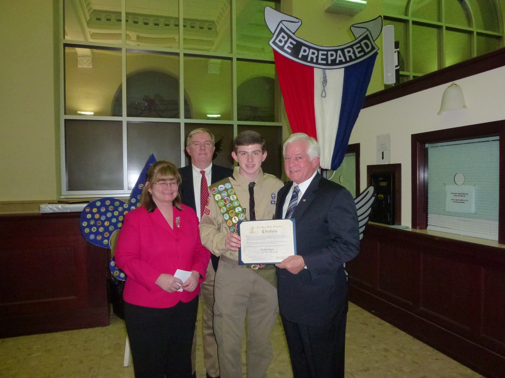 Assemblyman Charles Lavine, left, presented Brendan Rogers a member of Troop 6 in Glen Cove with a citation in recognition of his earning 39 merit badges to become an Eagle Scout. He completed a major community service project for the SCO Family of Services collecting and filling backpacks with personal care and recreational items for foster children. Brendan, who was joined by his parents John and Cindy, is a freshman at the University of Virginia where he is pursuing a degree in Engineering. The Eagle Scout ceremony took place at Glen Cove City Hall.
