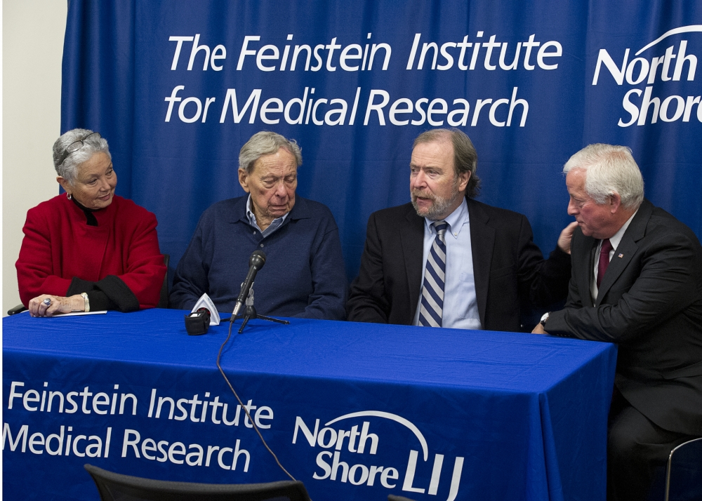 Assemblyman Charles Lavine (D-Glen Cove) right, listens as Dr. Peter Davies, PhD, Director, Litwin-Zucker Research Center for the Study of Alzheimer�s Disease makes a point during a press conference Thursday, November 7, at the Feinstein Institute for Medical Research in Manhasset to focus attention on the need for funding for Alzheimer�s Research. Joining Dr. Davies and Assemblyman Lavine are Dr. Richard Purdy, 83, and his wife Gloria, who have been married for more than 50 years. Dr. Purdy, a pioneer in vascular surgery, was diagnosed with Alzheimer�s disease in 2007 and has been receiving treatment at the Feinstein Institute, part of the North Shore-LIJ Health System. Assemblyman Lavine has sponsored a bill to seek voter approval for a $1 billion bond act to fund Alzheimer�s Research. The Alzheimer�s Research Bond Act of 2014 will need voter approval to move forward.