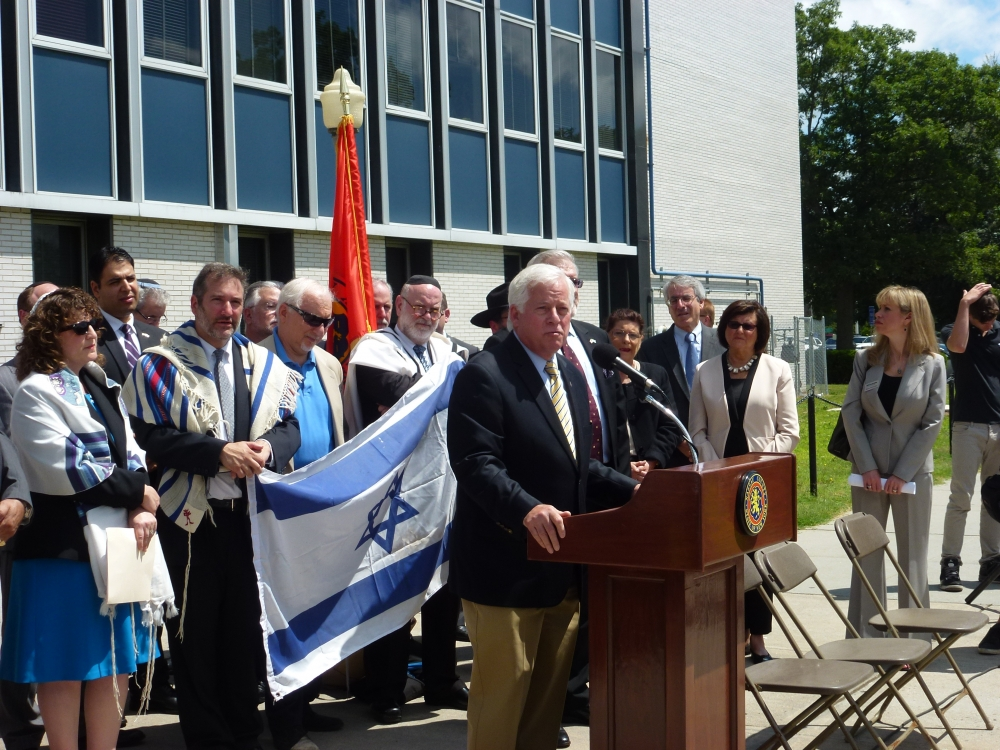 Assemblyman Charles Lavine, center, addresses the crowd that came together for the Jewish Community Relations Council�s solidarity rally for three Israeli teenagers � Eyal Yifrah, Gilad Shaer and Naftali Frenkel-  kidnapped by terrorists two weeks ago and their families. The event held on the steps of the Nassau County Human Rights Commission, brought together members of the Long Island community, religious leaders and public officials who condemned the abduction and offered prayers for the safe return of the young teens. Their cry to �Bring Back Our Boys� was repeated throughout the rally.