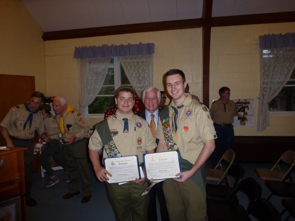 Assemblyman Charles Lavine (D-Glen Cove) presents Quentin T. Capobianco, left, and Dakota J. Martin with citations at their Eagle Court of Honor held at St. Luke�s Episcopal Church in Sea Cliff on May 22. The Eagle Scouts, who are members of Troop 43, were recognized for their accomplishment in earning their Eagle Scout badges. Assemblyman Lavine spoke at their induction commending them on their hard work and dedication in earning this honor.