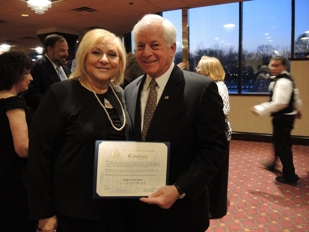 Assemblyman Charles Lavine, left, presents Ginger Lieberman, President of the Plainview-Old Bethpage Board of Education with a citation during the 2014 Nassau BOCES Education Partner Awards dinner at the Crest Hollow Country Club in Woodbury. The event recognizes the �Most Influential People for Public Education in Nassau County� annually. Categories include Education Partners, Nassau BOCES Employees, Organizations, School Board Members, Students and Teachers. Recipients were chosen for the honor from among dozens of nominees by a committee of distinguished educators and community leaders who identified individuals and organizations who personified the spirit of educational partnerships and had a measurable impact on public education in Nassau County.