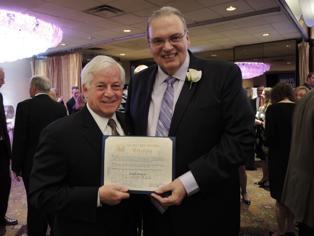 Assemblyman Charles Lavine, left, presents Joseph C. Dragone, Assistant Superintendent for Business for the Roslyn School District with a citation during the 2014 Nassau BOCES Education Partner Awards dinner at the Crest Hollow Country Club in Woodbury. The event recognizes the �Most Influential People for Public Education in Nassau County� annually. Categories include Education Partners, Nassau BOCES Employees, Organizations, School Board Members, Students and Teachers. Recipients were chosen for the honor from among dozens of nominees by a committee of distinguished educators and community leaders who identified individuals and organizations who personified the spirit of educational partnerships and had a measurable impact on public education in Nassau County.