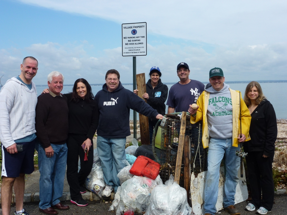 Assemblyman Charles Lavine, second from left, joined the Oyster Bay Democrats at Merritt Lane Beach in Bayville recently to perform a clean-up in conjunction with the Friends of the Bay�s Bay Clean-up. Each spring, members of the OB Democrats select a beach and head out to clear debris that has accumulated during the winter months. Helping out were from left, Adam Haber, Candidate for 7th Senate District, Chuck, Joe Lorintz, Candidate for Family Court, County Court Judge Tammy Robbins, Marissa Lorintz, Dan Milano, Dave Gugerty, Town Leader, Linda Dunkel.