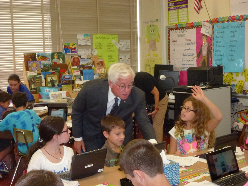 Assemblyman Charles Lavine (D-Glen Cove) talks to students in a fourth grade class at Parkway Elementary School in Plainview who are working with wireless tablets to conduct research for an assignment