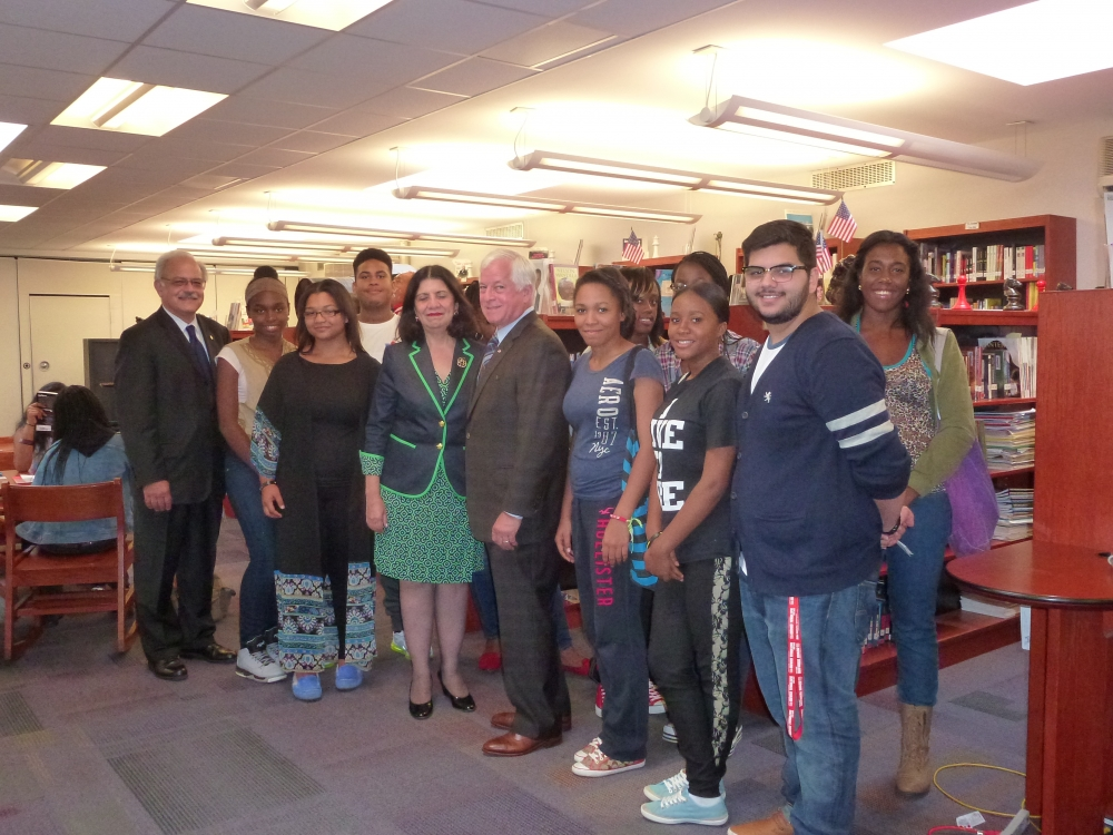 Assemblyman Charles Lavine, center, joined Dr. Mary Lagnado, Superintendent of Westbury Schools, Westbury High School Principal Manuel Arias, and students on a recent visit where they discussed the $500,000 state grant that Assemblyman Lavine secured for the district. The grant will be used for track resurfacing and drain repairs, to install a press box, a concession stand and football storage facility.