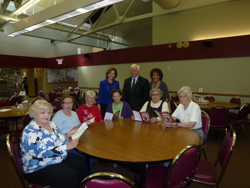 Assemblyman Charles Lavine (D-Glen Cove) joined Carol Waldman, to his right, Executive Director of the Glen Cove Office of Senior Services, and Lorraine Greenberg, to his left, Project Coordinator, during a visit to the Glen Cove Senior Center. Volunteers at the Center look over a new brochure for the Gray Matters Workshop Series � Opening the Door to Brain Fitness that was developed with funding from a $12,000 grant secured by Assemblyman Lavine. The grant was used for quality of life programs, including educational, recreational and social programs for seniors.