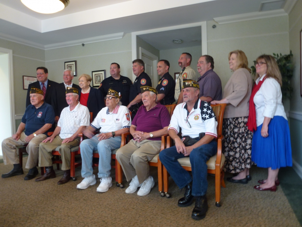 Assemblyman Charles Lavine (D-Glen Cove) second from left, participated in the Atria Senior Living Salute Our Heroes event this week at the senior facility in Plainview. Each year, Atria residents and staff recognize first responders for their efforts on behalf of the community with a brunch and musical entertainment. This year, seniors sang a series of patriotic songs to salute local responders on Patriots� Day. Joining Assemblyman Lavine was Plainview Water District Commissioner Andrew Bader, left, and Nassau County Legislator Judy Jacobs. Atria staff included Nancy Weblock, Engaged Life Director and Sharon Hayes, Executive Director of Atria, right. Veterans from VFW 5942 included: Peter McCann, Joe Ciaccio, Rocco Figalora, Gene Robinson, and Tom Fahrenholz. Responders from Nassau County Police Department Headquarters at 1490 Franklin Avenue, who were recognized, are: PO Hurtle, PO Taggart, and Sgt. Arnold. Bill Mayo, Chaplain of the Plainview Fire Department was recognized as well as Rob Freedman, NCPD AMT paramedic.