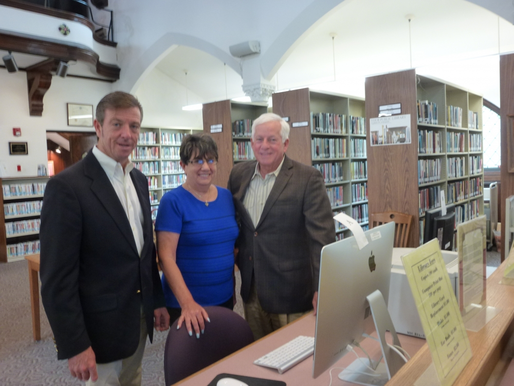 Arlene Nevens, Director of the Sea Cliff Village Library, center, shows Assemblyman Charles Lavine, right, and Sea Cliff Mayor Bruce Kennedy computers that were purchased at the Sea Cliff Village Library with a $2,250 state grant he secured to assist the library with providing community programs.