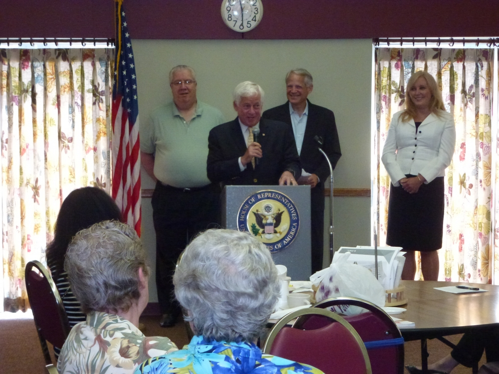 Assemblyman Charles Lavine addresses seniors who attended a Senior Solutions Seminar sponsored by Congressman Steve Israel, center, at the Glen Cove Senior Center on August 19. The expo provided an opportunity for residents of Glen Cove to gather information about the programs and services that are available to them through government and non-profits. A host of elected officials were on hand including Senator Carl Marcellino, rear left, and Nassau County Legislator Delia DeRiggi-Whitton, right.