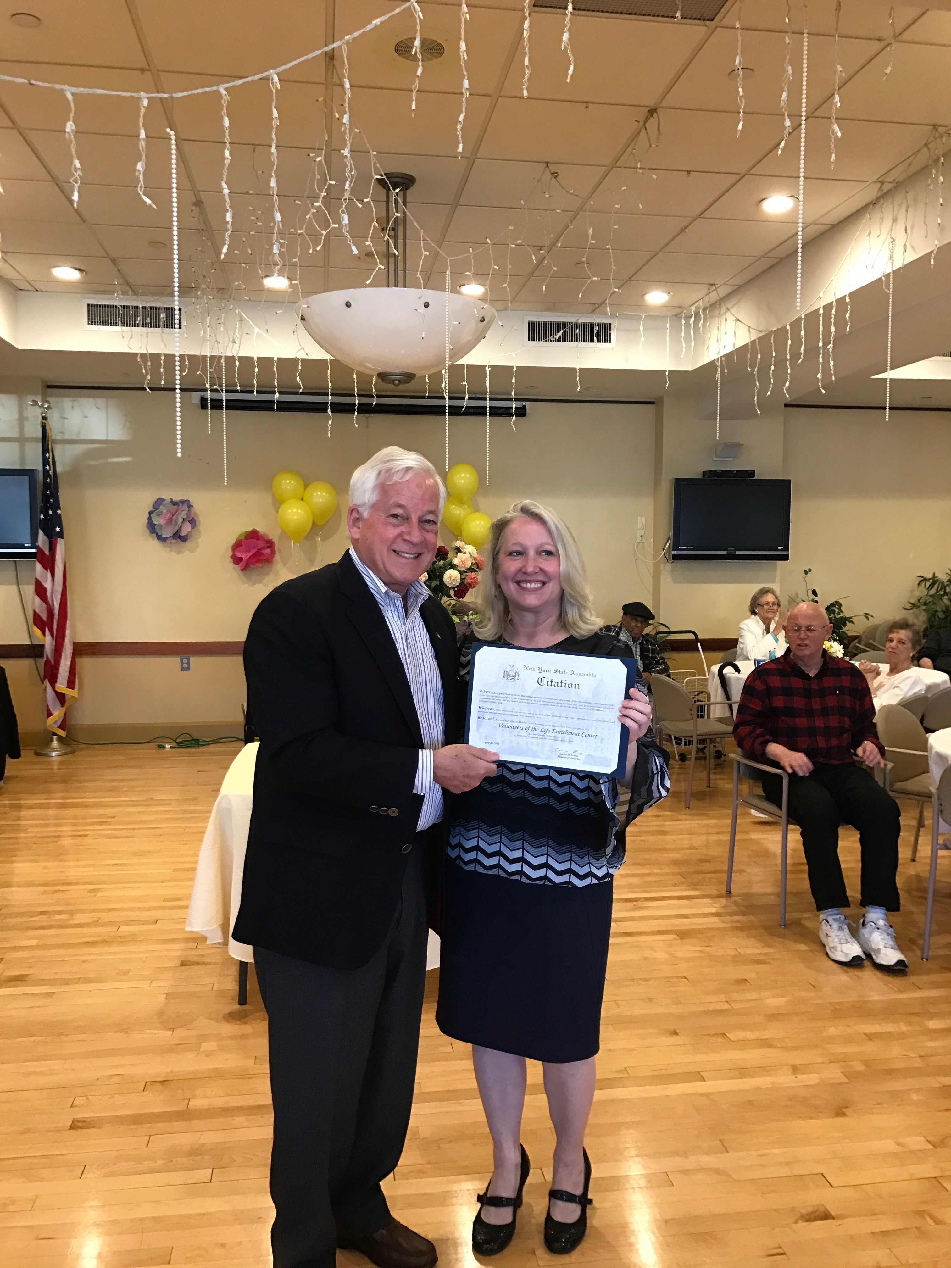 Pictured are Assemblyman Charles Lavine and Judy Palumbo, Executive Director of The Life Enrichment Center at Oyster Bay.