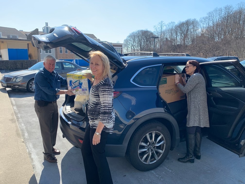 Assemblymember Lavine helps load over 300 paper goods in Lisa Cohen, the Executive Director of Living Water for Women's car. These paper goods were sorely needed items for Living Water for Women