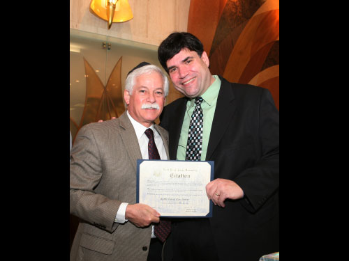 Assemblyman Charles Lavine recently attended the installation ceremony of Rabbi David Ross Senter of the Manetto Hill Jewish Center. Pictured are Assemblyman Lavine and Rabbi Senter.
