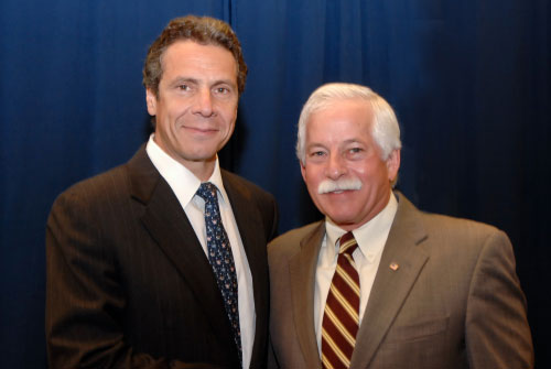 Assemblyman Charles Lavine welcomes Attorney General Andrew Cuomo to the Glen Cove Senior Center for a press conference on a healthcare credit card scam targeting elderly and vulnerable residents. (Photo credit Tony Gallego, Gill Associates Photography)
