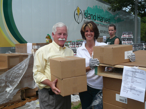On Thursday, July 16 Assemblyman Charles Lavine joined volunteers of Island Harvest�s third Summer Food Blitz where the group sorted, packaged and transferred approximately 500,000 pounds of donated food to more than 100 local agencies and food pantries for further distribution to persons in need. Pictured with Assemblyman Lavine is Randi Shubin Dresner, president and CEO of Island Harvest.