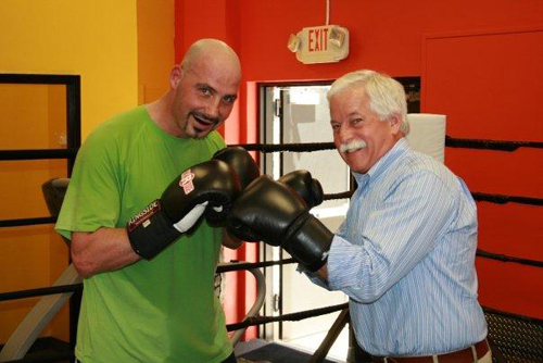 On Sunday, May 31 Assemblyman Charles Lavine faced mixed martial arts champion Derek Panza in the ring as part of a Mixed Martial Arts Marathon organized by North Shore student Alexandra Goidel for her Bat Mitzvah project. Mr. Panza agreed to spar 100 rounds with any and all takers. The very successful event raised funds to benefit the National Children�s Leukemia Foundation and 1 in 9: The Long Island Breast Cancer Action Coalition. Assemblyman Lavine said, �While I was still standing at the end of my round, I must admit it was much more impressive that Derek was standing at the end of his 100 rounds.�