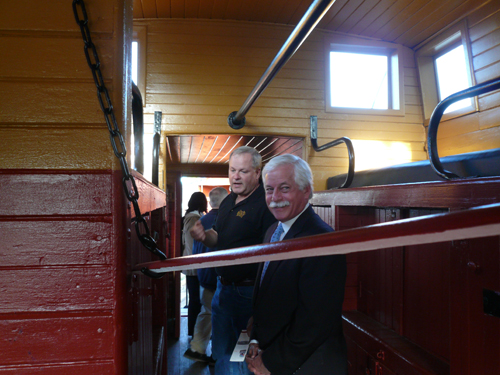 Assemblyman Charles Lavine headed to the Oyster Bay Railroad Museum for a tour of the equipment and cars the museum is compiling at the historic train station that was built in 1889 and used by Theodore Roosevelt during his presidency. The assemblyman made tracks to the steam engine, the passenger car, the caboose, and the museum�s newest acquisitions, two mini-locomotives that were used as switchers in the LIRR�s repair yard. He is pictured here with Ben Jankowski, chairman of the board, contemplating the less-than-first-class sleeping facilities for railroad crewmembers during their off-time on the Montauk to Oyster Bay run.