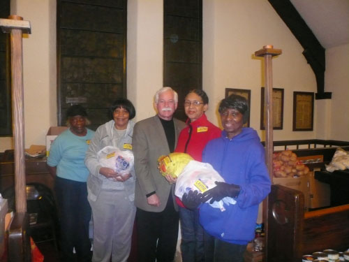 (Glen Cove) Assemblyman Charles D. Lavine donated 50 turkeys for good citizens from Westbury, who tirelessly collected all the trimmings, so they could prepare Thanksgiving baskets to give out to families who are in need. Pictured are Geraldine Odoms, Estelle Meyers, Assemblyman Lavine, Janice Williams and Mattye Williams at The Church of the Advent in Westbury.