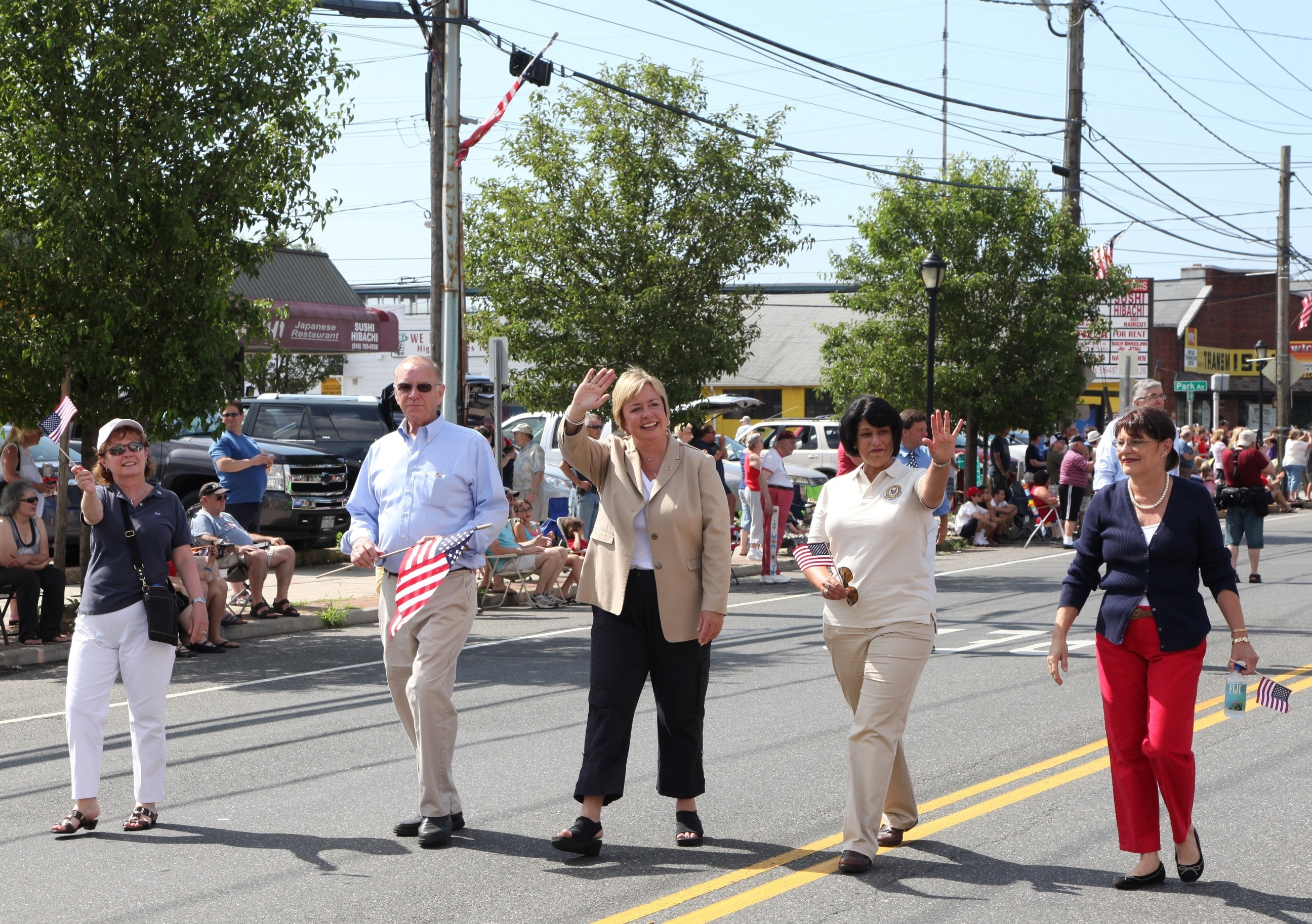 Assemblyman Dave McDonough and Town of Hempstead Supervisor Kate Murray (center) walk together during the Annual Wantagh 4th of July Parade.