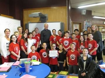 Assemblyman Dave McDonough presents an Assembly Citation to the Levy Lakeside Elementary School Student Council for taking part in his Coats for Kids drive.