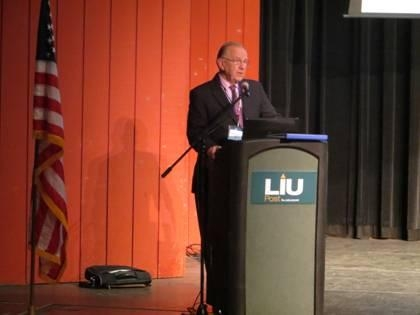 Assemblyman Dave McDonough welcomes attendees to the �Many Faces of Family Violence Conference� at Long Island University.