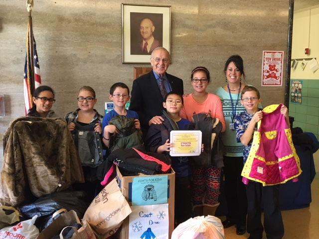 Assemblyman Dave McDonough (R,C,I-Merrick) (center back) recently thanked students and teachers at Fayette Elementary School with certificates for their donations to his annual Coats for Kids Drive. T