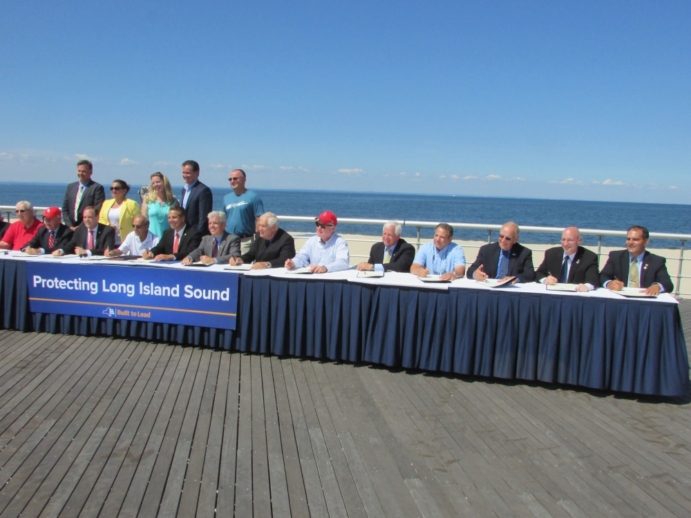 Assemblyman Dave McDonough (R,C,I-Merrick), pictured third from right, joins Governor Cuomo, state and federal representatives and environmental activists to pen a letter to President Obama threatening to sue if Long Island Sound becomes a dumping site for dredged material.<br />&nbsp;