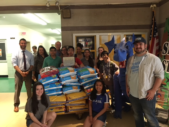 Assemblyman Dave McDonough [center back] joins members of Division Avenue High School&rsquo;s Key Club, Club Advisor Joann Medina, Principal John Coscia and William Gonyou of Long Island Cares Inc. and the Harry Chapin Food Bank to collect food for needy local pets.<br />&nbsp;