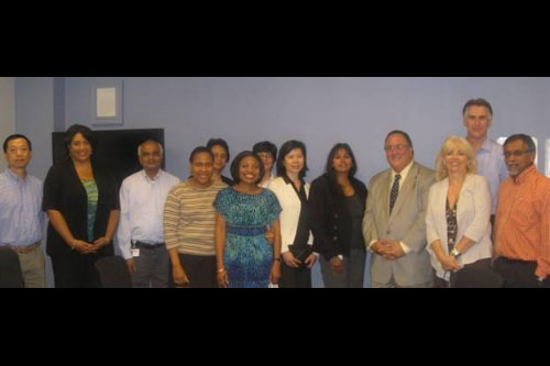 Assemblyman Michael A. Montesano (fourth from right) with employees from Endo Pharmaceuticals.