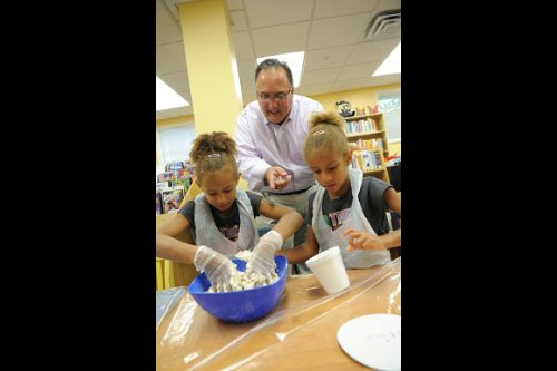 Assemblyman Michael Montesano highlights family-friendly activities at the Gold Coast Library.