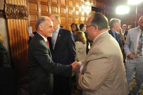 Assemblyman Michael Montesano (right) shakes hands with Larry Schwartz (left), one of the governor�s top advisors, after Stony Brook University�s NYSUNY 2020 plan presentation.