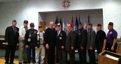 Local veterans with Assemblyman David G. McDonough (fifth from left) and Assemblyman Michael A. Montesano (fifth from right).