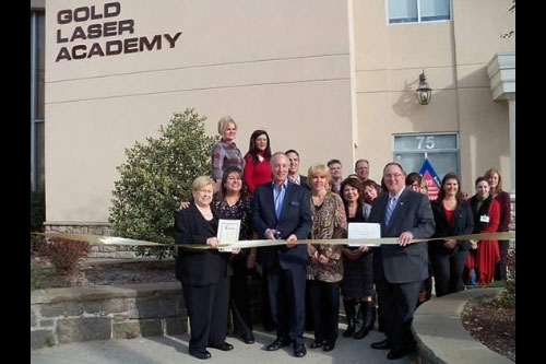 Left to right, front row, Legislator Judy Jacobs, Alan Gold (M.D., F.A.C.S., Medical Director of Gold Laser Academy), Cindi Gold (R.N.), Victoria Quiroz (Director of Education), and Assemblyman Montesano at the ribbon-cutting of Gold Laser Academy.