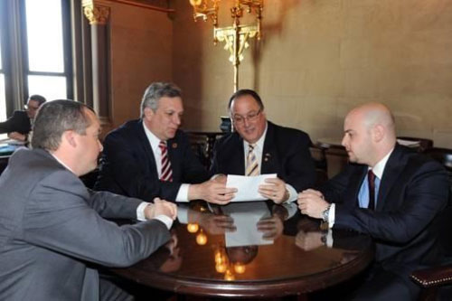 From the left, Nassau Deputy County Executive Robert Walker, Nassau County Executive Edward Mangano, Assemblyman Michael Montesano and Nassau County Spokesman Brian Nevin discussing the impact of the 2012-13 budget on their county.