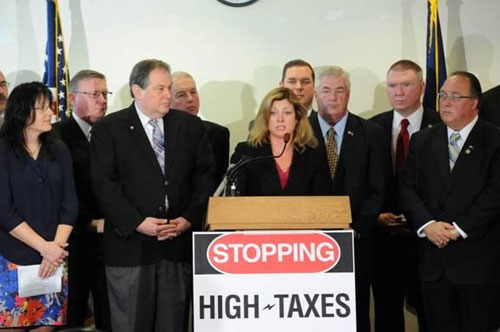 Assemblyman Michael Montesano (far right) at a press conference calling for the elimination of the 18-A energy tax.