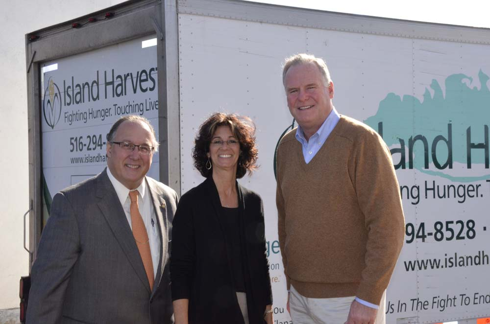 Assemblyman Michael Montesano (left) stands with President & CEO of Island Harvest Randi Shubin Dresner and Assemblyman Michael Fitzpatrick (R,C,I � Smithtown).